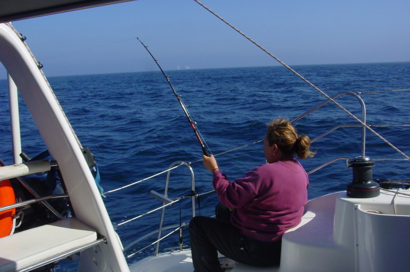 Ruth bending a rod with a Yellow Fin Tuna